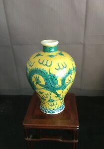 A Chinese Yellow Background with Green Dragon Decoration