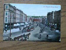Lovely clear clean card of St Patrick Street in Cork.   Trams ,horses  1910 ish