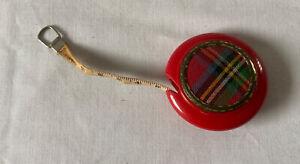 """Vintage DEAN 40"""" 'Self Winding' TAPE MEASURE Red tartan Plastic Disc."""