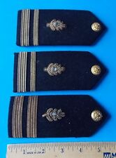 LOT OF THREE MILITARY SHOULDER BADGES WITH BUTTONS