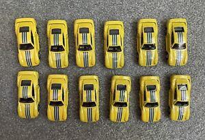Lot of Twelve 1987 Hot Wheels Metallic Yellow/Gold Porsche 959s - Used.