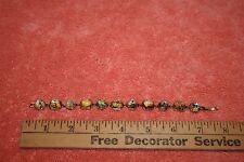 Goldtone Metal & Foil back Plastic Stones Link Bracelet