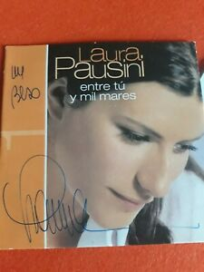 LAURA PAUSINI  CD PROMO AUTOGRAFO ENTRE TU Y MIL MARES . SIGNED