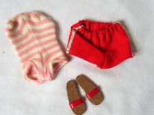 1962 Barbie pink / white bathing suit and Ken's red shorts and red sandals