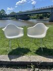 Two Vintage MCM Eames Herman Miller Molded Fiberglass Arm Chairs