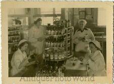 Women making drugs pharmacy vintage photo