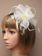 Cream Looped Net Ribbon Feather Fascinator on a Clear Hair Comb Weddings Races