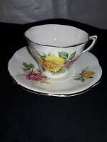 bone china cup and saucer made in England gold trim with roses