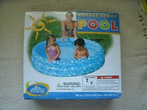 """CHILDS INFLATABLE BUBBLE SPRAY SWIM POOL 58"""" X 13"""" HOLDS 74 GAL WATER"""