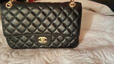 Chanel Flap Bag Vintage Black borsa trapuntata in pelle nera tracolla