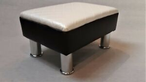 Black and White faux leather footstool.