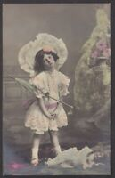 Edwardian child girl with her doll antique tinted real photo postcard 1907