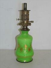 LAMPE A PETROLE EN OPALINE VERTE ET DORE.Epoque Charles X.