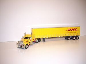 DCP FIRST GEAR 1/64 DHL MACK SUPER-LINER WITH SLEEPER AND 53' UTILITY TAUTLINER