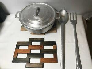2 Jamaican multi wood Trivets, dutch pot and long handle cooking utensils