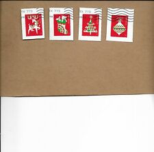 NEW 2020 HOLIDAY DELIGHTS SET OF FOUR STAMPS USED ON PAPER