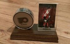trophy display hockey sports card & hockey puck Eric Lindross Scott Stevens NHL