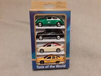 TAXIS OF THE WORLD DIECAST FOUR CAR SET MEXICO LONDON NEW YORK MIDDLE EAST MODEL