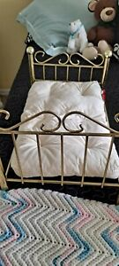 Brass looking Doll Bed  with mattress and blanket