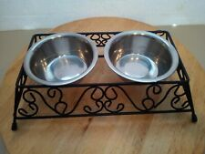 Cat or Small dog water and food bowls on wrought iron stand.