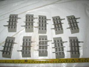"10 Lionel O gauge Fastrack 1-1/4"" straight tracks."