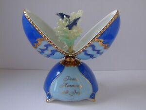 A Beautiful Bradford Exchange  Musical Egg Jewel of the Waves.....Dolphins