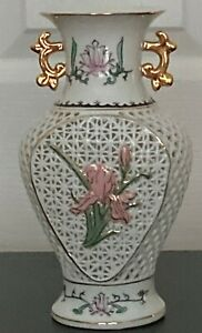 Chinese reticulated (pierced) porcelain Urn with flowers and gold trim