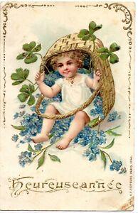 CPA- En relief - Heureuse Année - / Enfant dans panier - Trèfles
