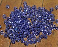 New lot 144 pieces of Genuine Swarovski crystals - Tanzanite 4mm - A2786c