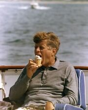 President John F. Kennedy eats ice cream on board the Honey Fitz New 8x10 Photo