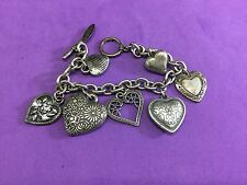 bracelet. multiple kinds of hearts Aeropostale signed silver tone charm