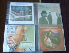 4 SEALED MUSIC CD LOT - TOM PETTY GREATEST HITS, ENRIQUE, 38 SPECIAL, BEE GEES,