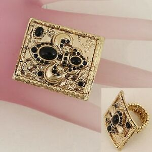 Gold Tone Fleur de Lis Ring Womens Size 8 to 13 Stretch with Black Stones