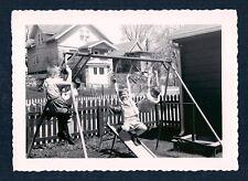 Boys Playing on Swing Set Evocative Image Vintage Photograph 1950's-60's