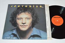 GASTON COUTURIER Je Cherche Un Monde LP 1978 Heritage Records AG-23000 VG+/VG