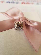 Genuine Pandora wedding ring pillow with gold and diamond.