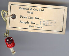 VINTAGE RED CELLULOID KOBE POP EYES DANGLY LEGS CHARM ON DODWELL ORIGINAL TAG