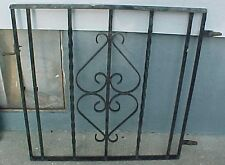 Heavy wrought iron fence gate