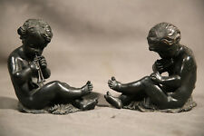19th Century  Pair of seated Bronze cherubs playing instruments Victorian