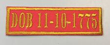 "CUSTOM BIKER VEST PATCH DOB 11-10-1775. 3 1/2"" X 1"" IRON.SEWON (GOLD ON RED)"