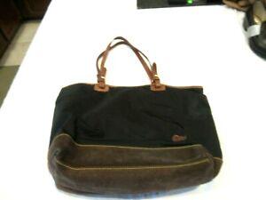Dooney and Bourke black purse with brown leather trim, suede bottom, handbag