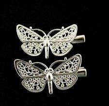 2 x small butterfly hair clips (both face left)