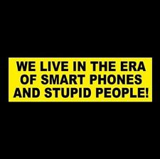 "Funny ""WE LIVE IN THE ERA OF SMART PHONES AND STUPID PEOPLE"" bumper sticker"
