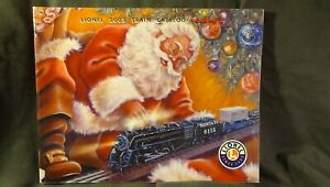 lionel Train Catalog w/ Santa on front playing with train 2003
