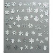 Accessoire ongles, nail art noël : flocons et bonhomme de neige argent et blanc