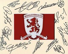 A 10 x 8 inch mount personally signed by 13 Middlesbrough players on 10.02.2015.