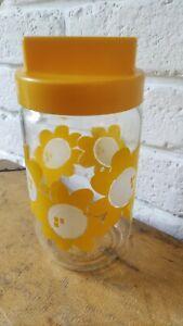 Pot en verre henkel à fleurs jaunes 70's