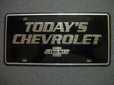 NOS Small hole Black Today's Chevrolet GM Dealership License Plate Nice!