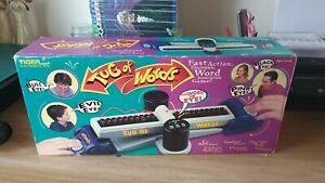 TIGER ELECTRONICS VINTAGE TUG OF WORDS GAME BOXED FULL WORKING ORDER MANUAL