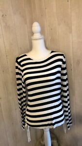 Women`s long sleeve top size 16 colour is black and white made by f&f new with t